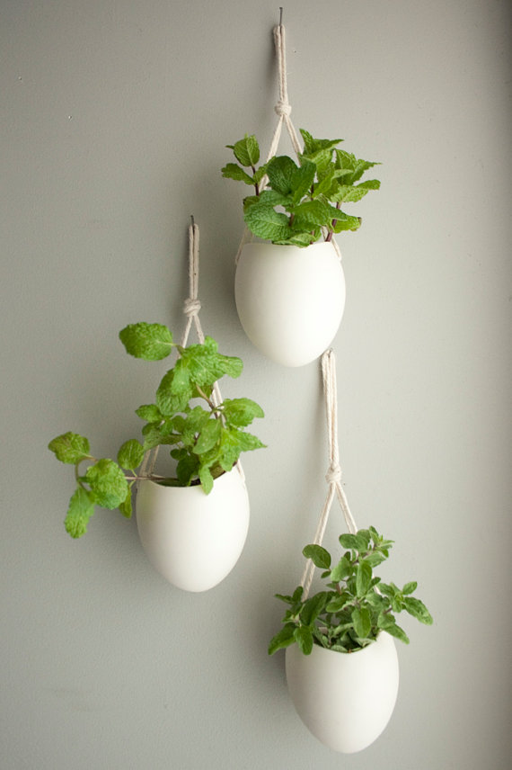 This set of three porcelain and cotton rope hanging planters is ideal to  start your own organic installation or herb garden. Each container is hand  made and ...